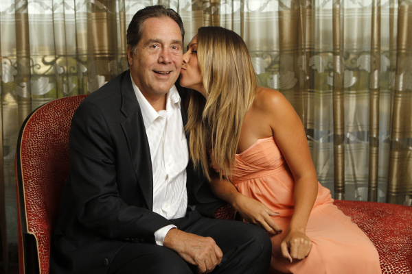 Music recording artist Colbie Caillat gives a kiss on the cheek of her father, record producer Ken Caillat, while posing for a portrait in Beverly Hills